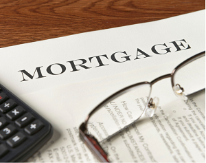 Picture of a mortgage document with pair of glasses sitting on it.
